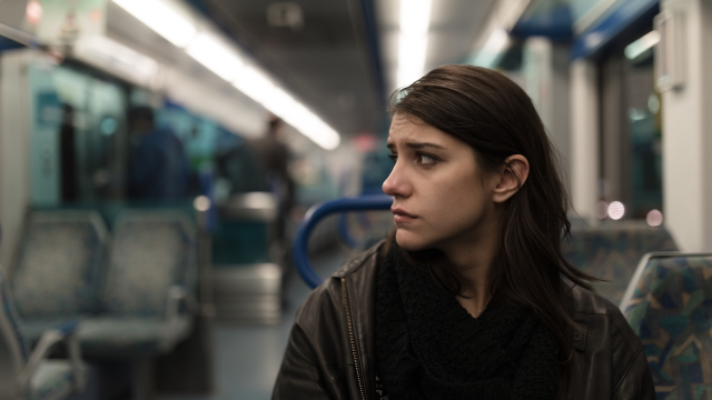 Woman shares story of stranger on train asking for help with an impending seizure.