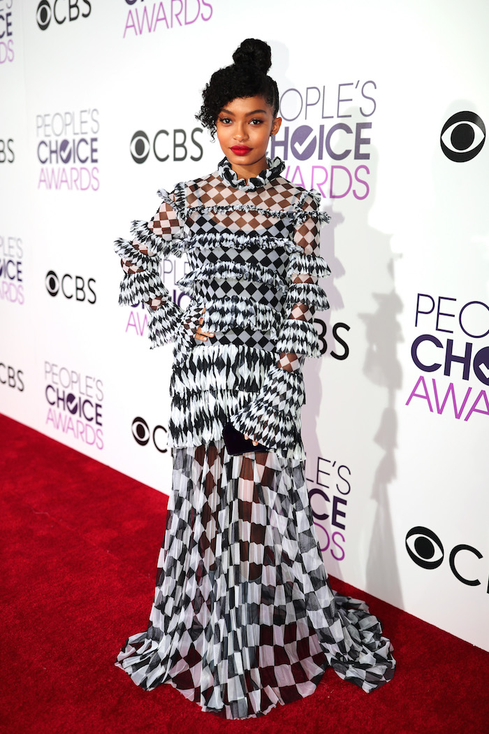 What is the gorgeous French clown madness going on with Yara Shahidi's dress?