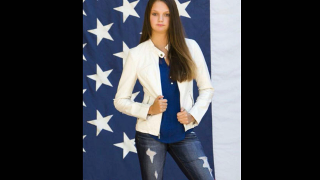 A girl's yearbook photo turned into a fight with her teachers over who really loves the flag.