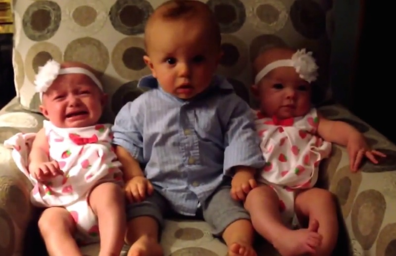 This baby boy's mind is blown when he meets twin baby girls.