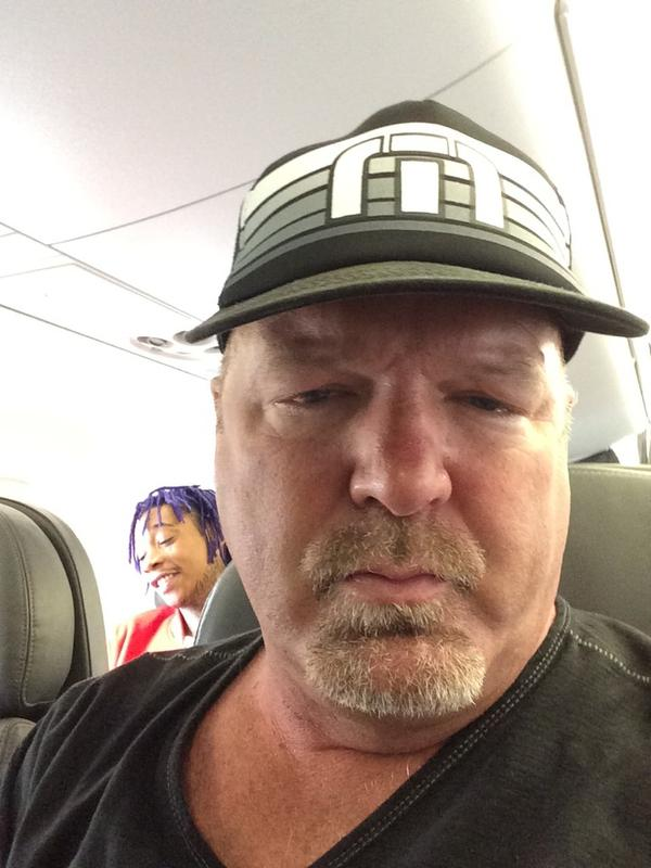This is what it looks like when a dad sits near rapper Wiz Khalifa on a plane.