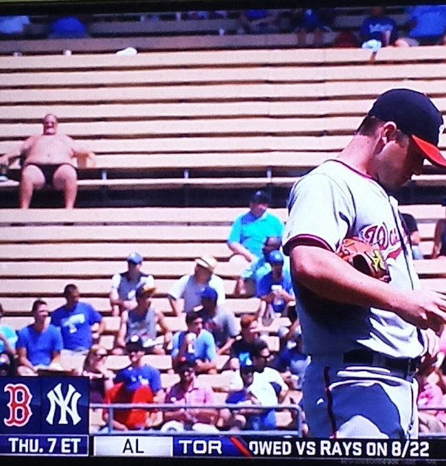 Half-naked dude soaking up the sun at a Dodgers stadium has become an instant fan favorite.
