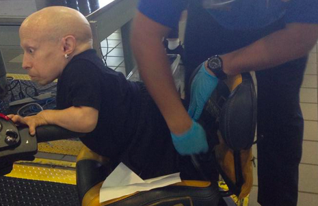 Verne Troyer is treated to a full-service inspection by the TSA.