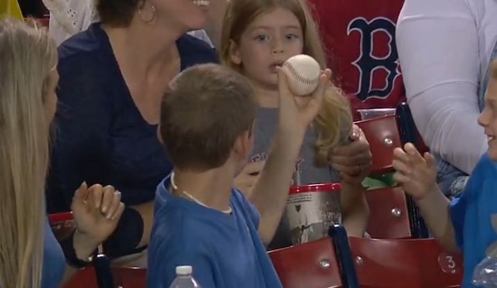 A young Sox fan was handed a foul ball, and he immediately handed it over to the little girl behind him. Because he's cool like that.
