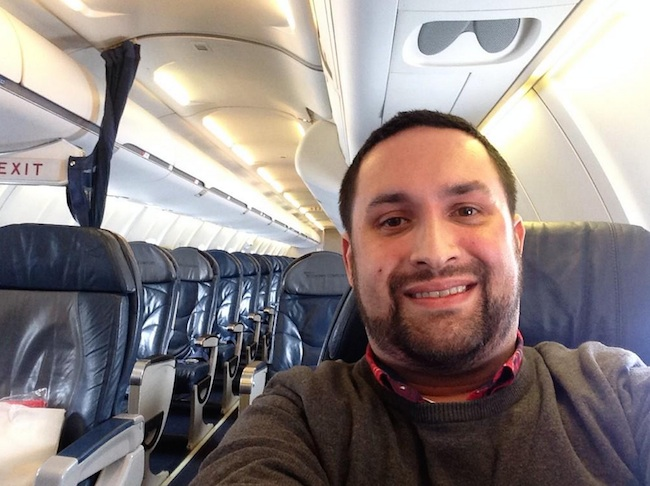 Lucky flyer tweets out photos after realizing he practically had the entire plane to himself.