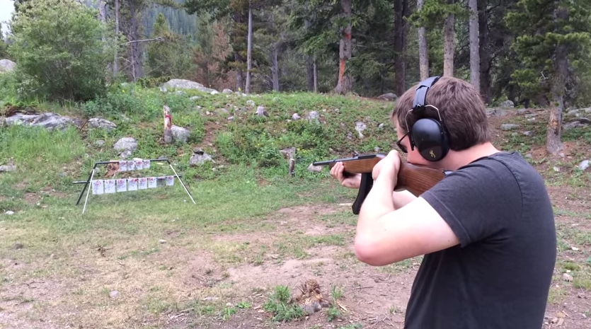 Some dude plays the Star Spangled Banner with an automatic rifle.
