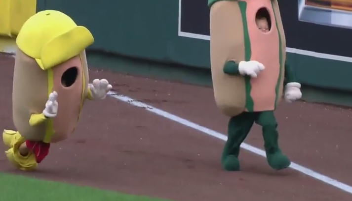 A kid dressed as a hotdog lost his pants while racing and then he fell down. Ha ha!