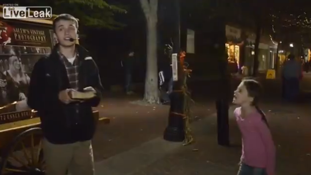 "Little girl screams at street preacher to ""shut his pie-hole."""