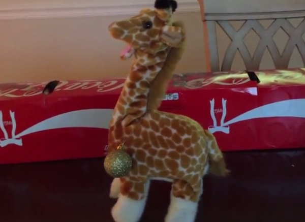 This screaming, possessed giraffe toy is ready to celebrate Christmas in hell.