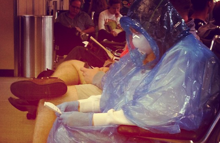 This photo of a woman wearing a homemade Hazmat suit to the airport is going more viral than Ebola.