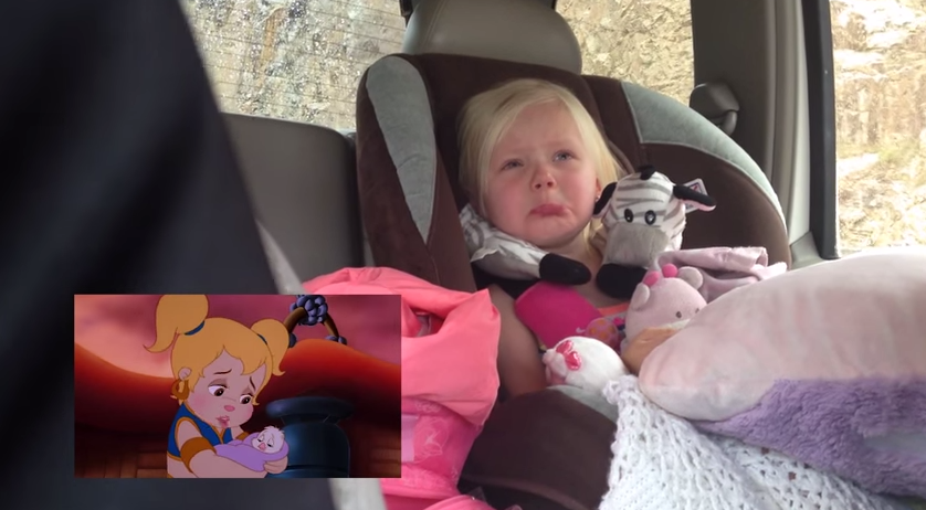 Toddler just cannot hold it together while watching her sad cartoon.