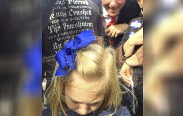 Bill Clinton photobombed a little girl who hates politics.