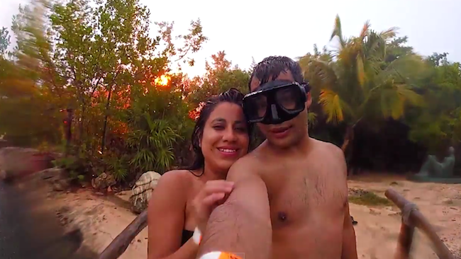 A couple taking a vacation selfie are nearly struck by lightning.