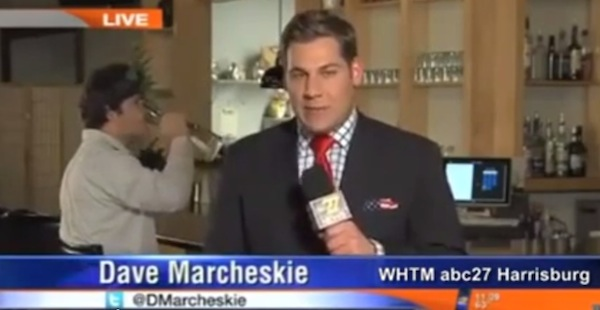 Local news war results in a very weird background activity during live report.