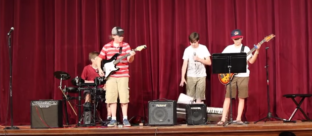 This junior high rock performance probably could have gone better.
