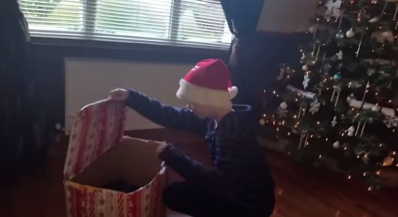 A month after his dog died, this kid's family surprised him with a new puppy on Christmas morning.