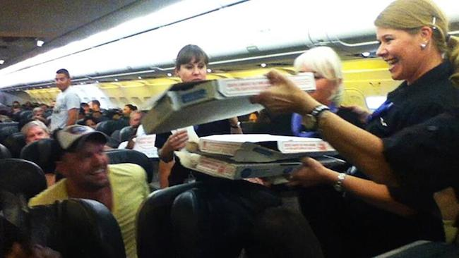 An airline pilot ordered pizza for 160 passengers who were stuck on his plane.