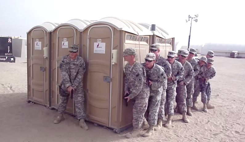 Twelve U.S. soldiers somehow cram themselves into a single porta-potty.