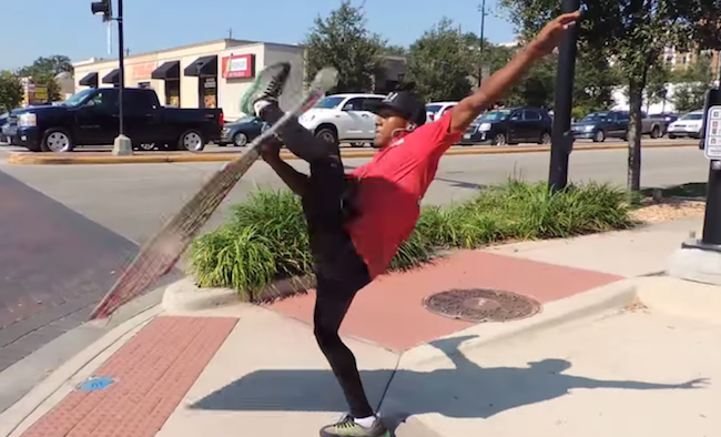 This acrobatic sign spinner is insanely good at his job.