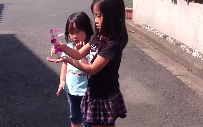 This flying toy fairy is totally done being played with by these two little girls.