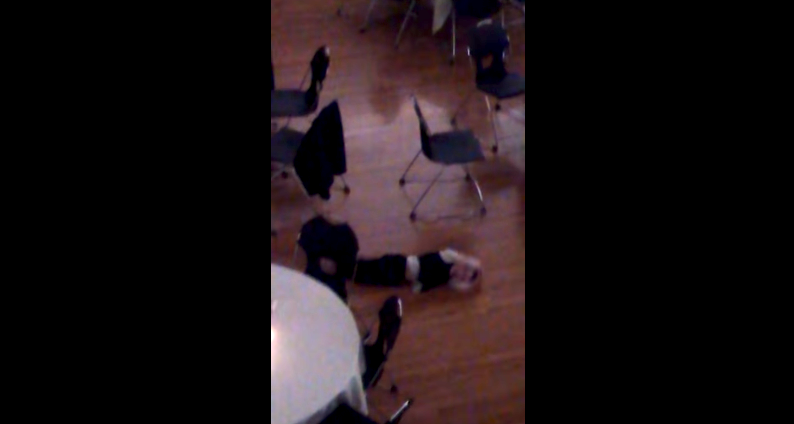Bored little kid at a wedding invents 2015's killer new dance move.