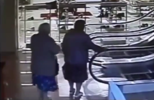 This older woman has a fresh take on how to approach an escalator ride.