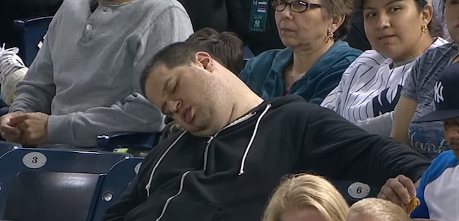 The guy who fell asleep during a Yankee game would like $10 million for his pain and suffering.