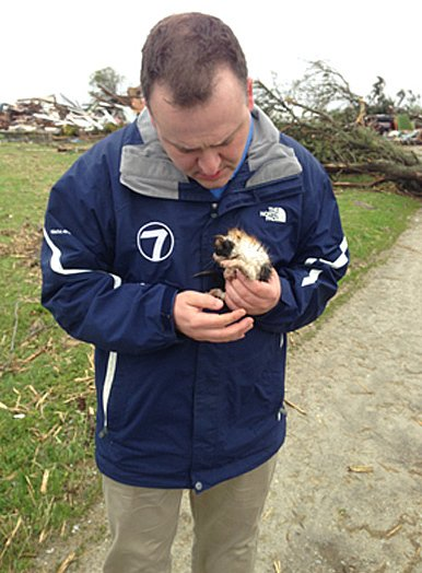 A meteorologist rescued a tiny kitten from the aftermath of a tornado.