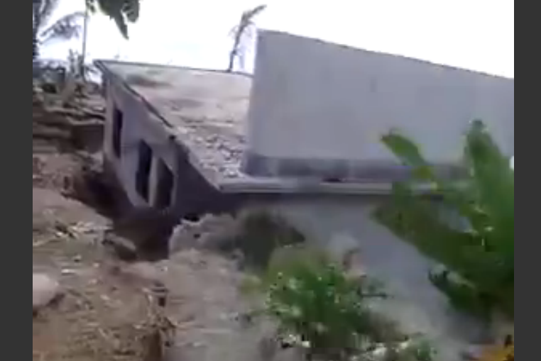 Watch an entire beach house get swallowed up by the ocean.
