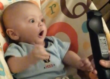 You will never love anything as much as this baby loves that TV remote.