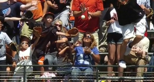 A woman's beer cup got obliterated by a home run ball. See ya!