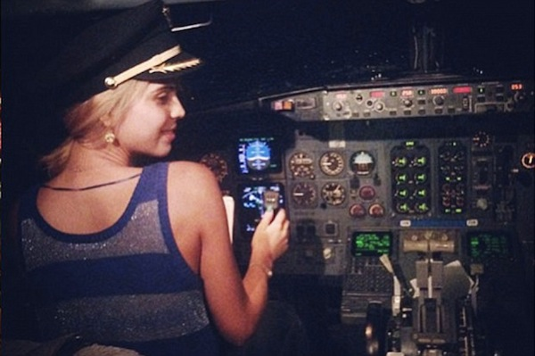 Pilot fired after two hot women post photos to Twitter of that time he let them fly the plane.