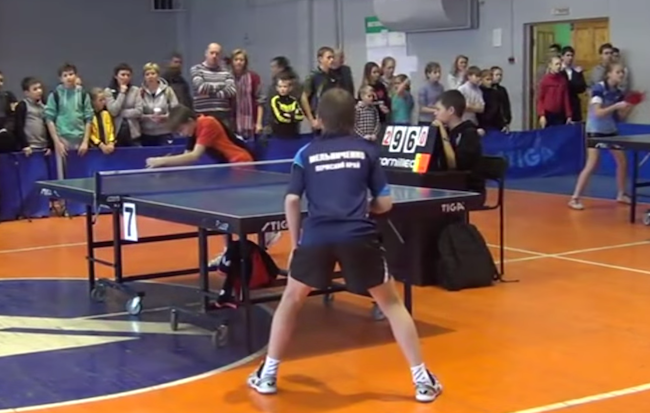 Angry young ping pong player dumps the ref on his ass after losing at ping pong.
