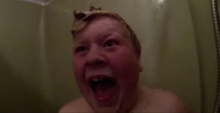 Dad puts on a mask to terrify his son, who is belting Katy Perry in the shower.