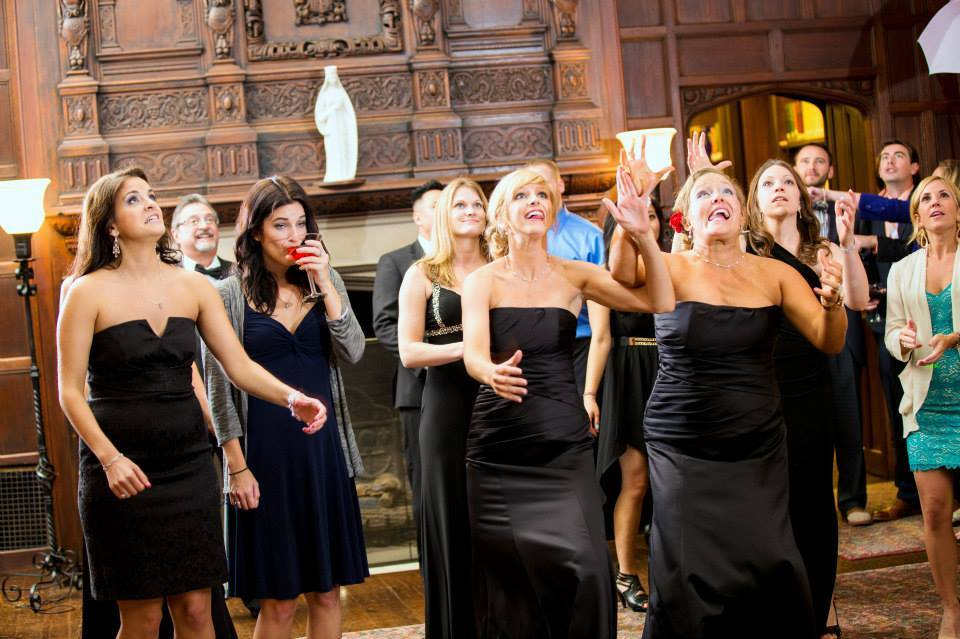 Wedding guest face first in her drink while everyone else lunges to catch the bouquet.
