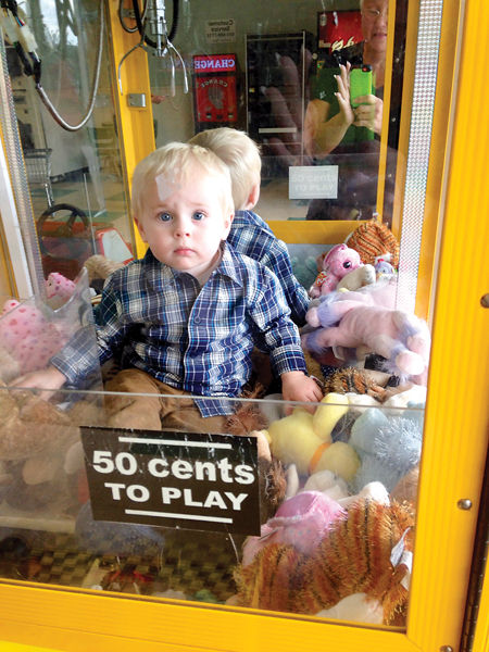 A toddler crawled into a claw machine and got himself trapped.