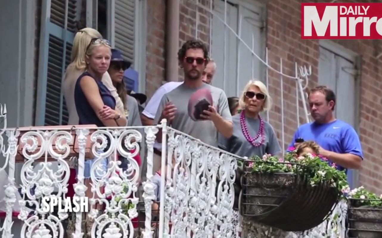 Just Brad Pitt and Matthew McConaughey tossing each other beers on balconies across the street in New Orleans.