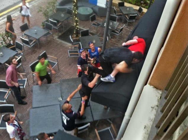 Man falls out of bar window in reaction to Portugal's last-second goal against the USA.