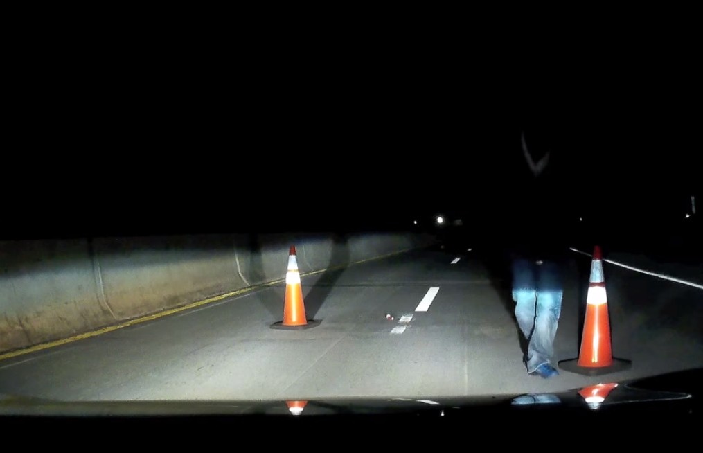 Something very creepy is happening in this dash-cam footage of a suspicious roadblock.