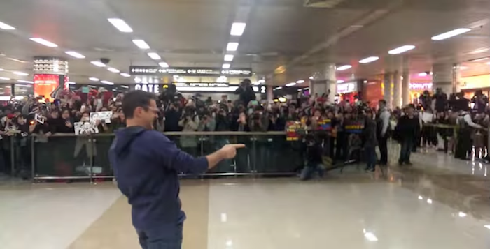 Robert Downey, Jr. walks into a South Korean airport; the result would make The Beatles envious.