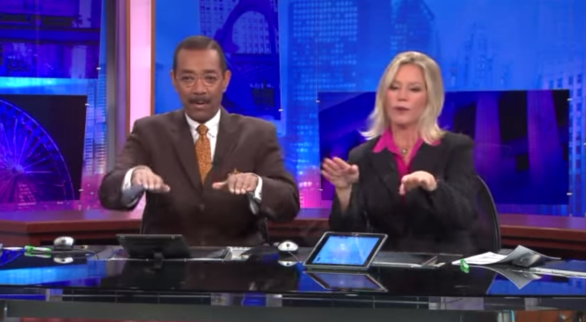 A couple of local news anchors have created the most amazing secret handshake.
