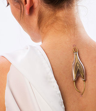 A woman has developed jewelry that you can plug into your body and charge your phone with.