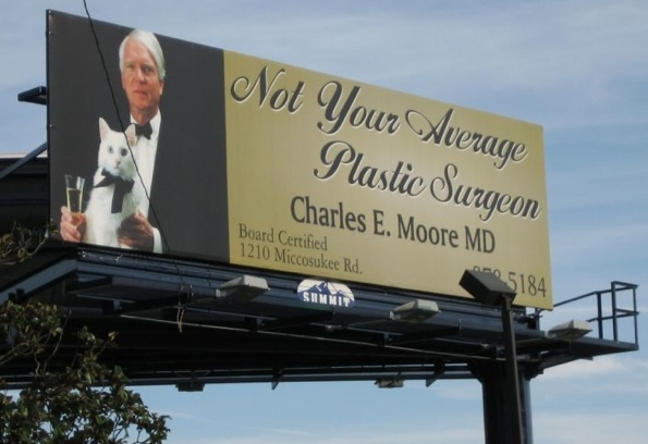 Billboard advertises plastic surgeon who may or may not be a criminal mastermind.