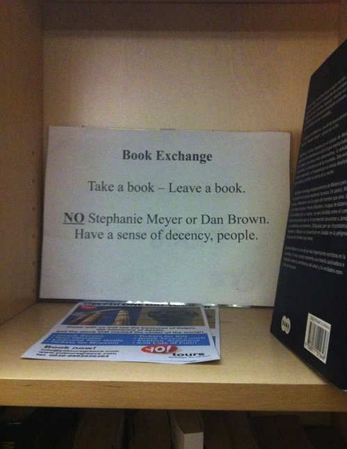 Book exchange posts hilariously judgmental warning sign.