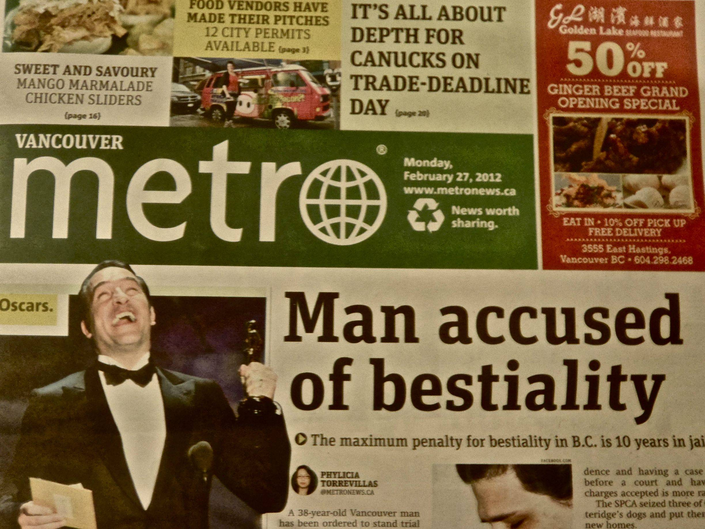 Unfortunate newspaper layout implies guy from 'The Artist' may have had sex with dog from 'The Artist.'