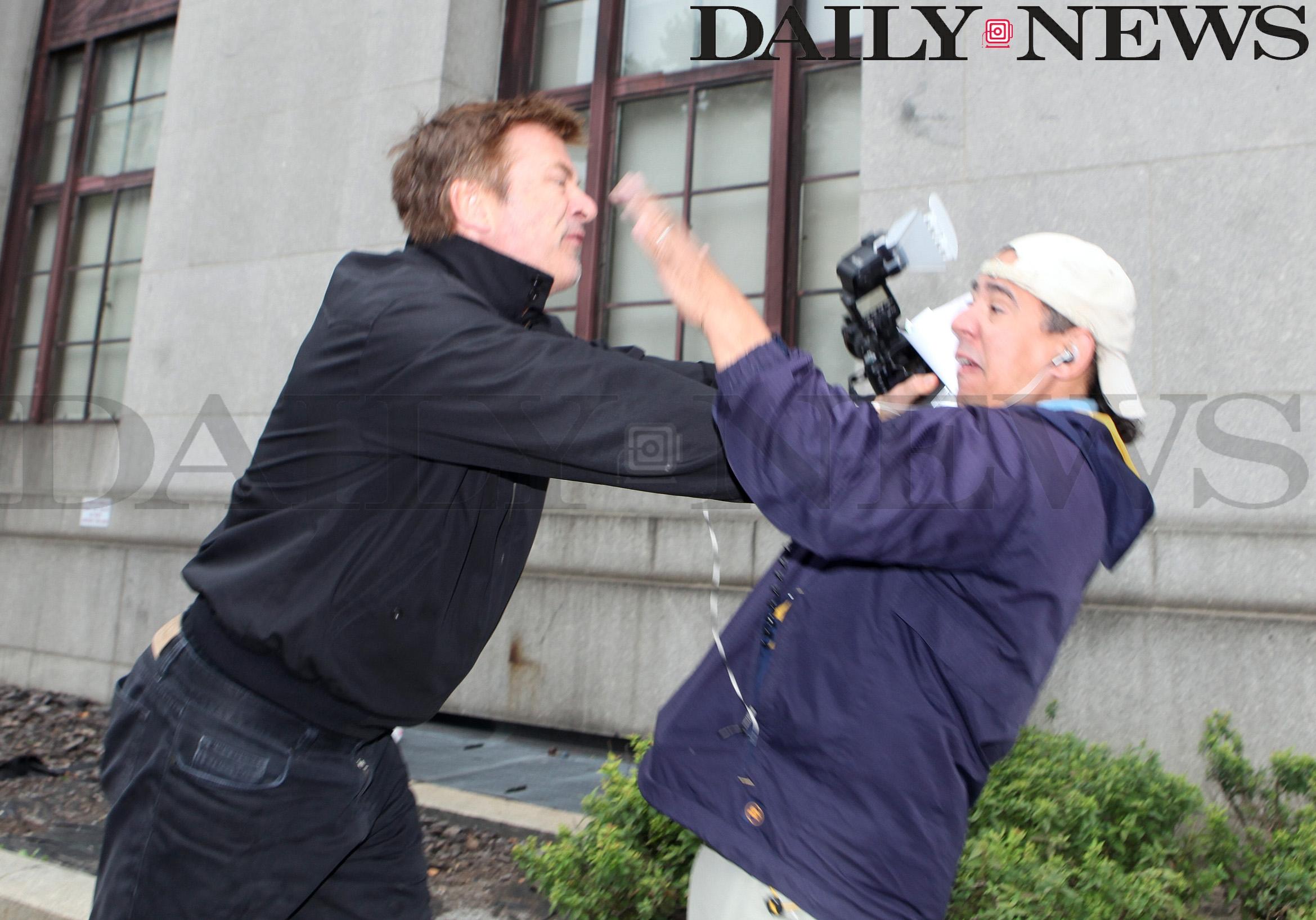 Alec Baldwin photographed punching photographer.