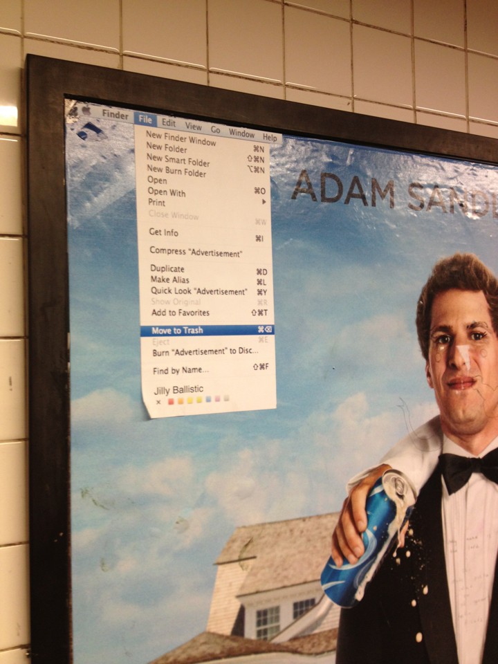 The most tech-savvy way to vandalize an Adam Sandler movie poster.