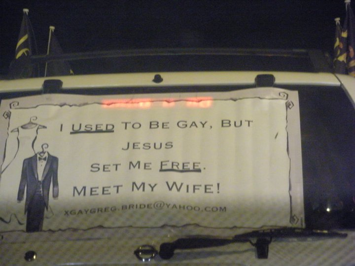Extremely gay man uses car window to lie about not being gay anymore.