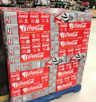 Supermarket accidentally commits hate crime with soda display.