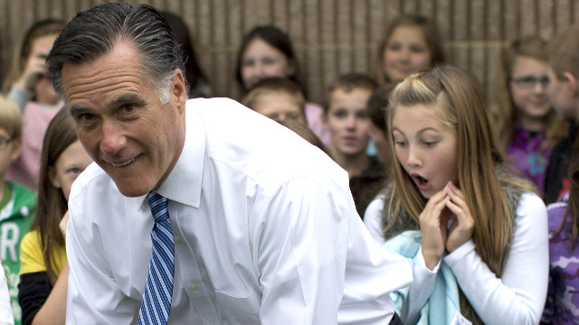 Best campaign photo yet of Mitt Romney seemingly showing his ass to a schoolgirl.